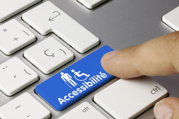 Clavier d'ordinateur avec des symboles représentant des personnes en situation de handicap